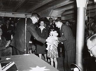 Post-war immigration to Australia - Mr Arthur Calwell with the Kalnins family - the 50,000th New Australian - August 1949