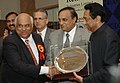 "Kamal Nath giving away the Lifetime Achievement Award to Shri R.L. Toshniwal at the Federation of Indian Export Organization (FIEO) ""Niryat Shree"" and ""Niryat Bandhu"" awards presentation ceremony, in New Delhi.jpg"