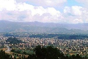Bisnumati River - River Vishnumati, a tributary of Bagmati, flowing near city with hills in the background