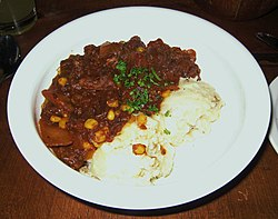 Kentucky burgoo served with mashed potatoes