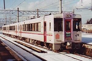 Akita Relay - KiHa 110-300 series DMU on an Akita Relay service at Akita Station, January 1997