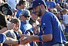 Kris Bryant signing autographs during his rehab assignment against Omaha (43598078794).jpg