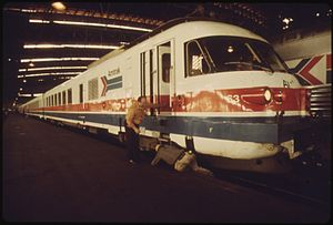 LAST MINUTE CHECK OF THE ENGINE OF THE AMTRAK TURBOLINER PASSENGER TRAIN IS MADE BEFORE DEPARTURE FROM ST. LOUIS... - NARA - 556059.jpg
