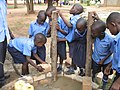 Laying of bricks by pupils in Muteesa PS (5567265373).jpg