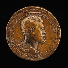 Left-facing profile portrait by and of the artist Leone Leoni, from 1541, struck in bronze, as a medal, in the collection of the National Gallery of Art in Washington, DC. The bearded gentleman with wavy hair and pointed chin faces to his left, in reddish brown metal, 4.26 centimeters across. Surrounding the head, in a circle are the images of four groups of four chain links, and four groups of double oxen yokes.