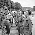 Lieutenant Colonel Charles Vaughan, Commandant Commando Depot, inspecting French troops during a parade to mark Bastille Day at Achnacarry in Scotland, 17 July 1943. H31439.jpg