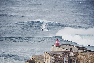 Garrett McNamara - Image: Lighthouse overlooking the waves (Unsplash)