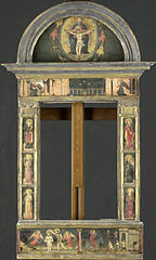 Frame painted with the annunciation, the baptism of Christ, the entry into Jerusalem, the Saints Cecilia and Catharina, and 4 angels making music