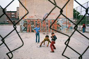 """Danny Lyon - """"Three boys and 'A Train' graffiti in Brooklyn's Lynch Park in New York City."""" By Danny Lyon, Brooklyn, NY, July 1974"""