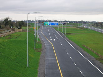 Shoulder (road) - A junction on the M4 motorway in Ireland, with an unbroken yellow line (that peels away and follows the sliproad) demarcating the hard shoulder.