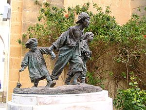 Gavroche - Gavroche and his brothers, sculpture in the Upper Barrakka Gardens, Valletta, Malta.