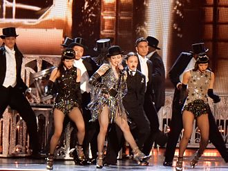"Music (Madonna album) - Madonna and her dancers performing the title-track ""Music"", during the Rebel Heart Tour (2015–16)."