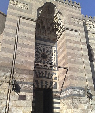 Mosque-Madrassa of Sultan Barquq - Entrance gate, covered by iwan decorated with muqarnas.