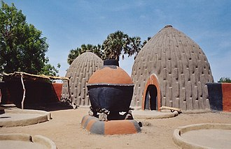 Cameroon - The homes of the Musgum, in the Far North Region, are made of earth and grass.