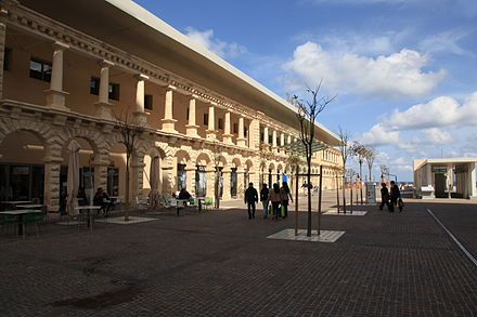 Parts of The Point Shopping Mall still include some architectural elements from the former Tigne Barracks. Malta - Sliema - Tigne Point - Pjazza Tigne+The Point 02 ies.jpg