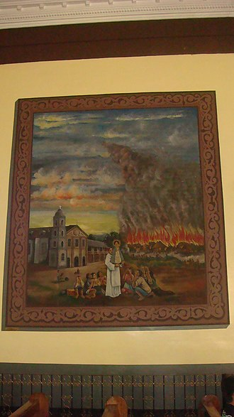 Our Lady of Manaoag - Mural in the transept depicting of the image sparing the town from a wildfire.