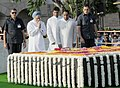 Manmohan Singh paying homage at the Samadhi of Mahatma Gandhi on his 142nd birth anniversary, at Rajghat, in Delhi on October 02, 2011. The Union Minister for Urban Development, Shri Kamal Nath is also seen.jpg