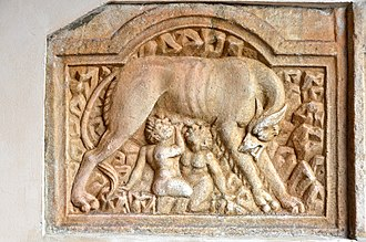 Comparative mythology - Ancient Roman relief from the Cathedral of Maria Saal showing the infant twins Romulus and Remus being suckled by a she-wolf
