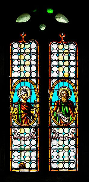 Stained-glass window of the Mary Magdalene church in Gramond, Aveyron, France