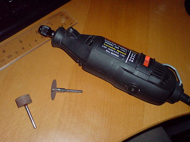 Mazda Guide-Protege 5-Removing Factory Stereo-Dremel.jpg
