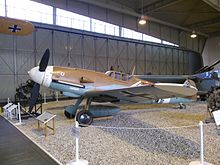 a colour photograph of an aircraft in a museum