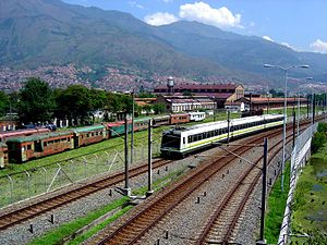 Antioquia Railway - Medellín Metro alongside old trains belonging to the Antioquia Railway