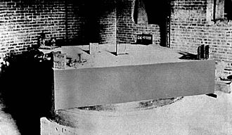 Michelson–Morley experiment - Figure 1. Michelson and Morley's interferometric setup, mounted on a stone slab that floats in an annular trough of mercury.