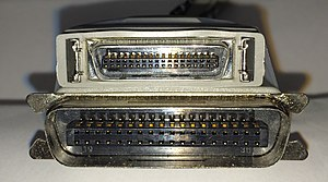 Parallel port - Mini-Centronics 36 pin male connector (top) with Micro ribbon 36 pin male Centronics connector (bottom)