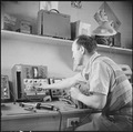 Minidoka Relocation Center, Minidoka, Washington. Radio Repair shop. Chester Sekura, radio repairman. - NARA - 536539.tif