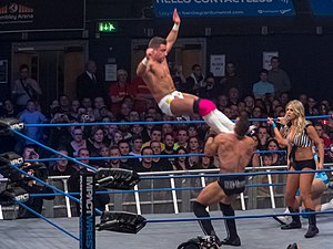 Dropkick - Marty Scurll performs a missile dropkick.