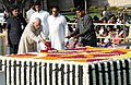 Mohd. Hamid Ansari paying floral tributes at the Samadhi of Mahatma Gandhi on his 142nd birth anniversary, at Rajghat, in Delhi on October 02, 2011. The Union Minister for Urban Development, Shri Kamal Nath is also seen.jpg