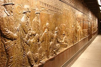 Memorials and services for the September 11 attacks - Bronze wall mural dedicated to the fallen firefighters, South of the WTC site