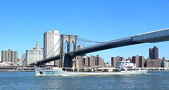 New York City Department of Environmental Protection - Sludge boat passing under the Brooklyn Bridge on the East River