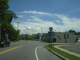 New York State Route 12E - NY 12E at Bridge Street in Brownville. While signage indicates that NY 12E turns here, it officially continues straight onto CR 190.