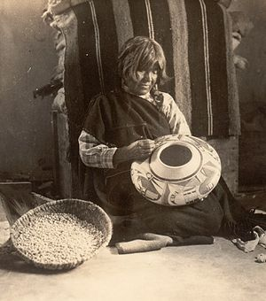 Nampeyo - Nampeyo with one of her Sikyátki Revival vessels, ca. 1908–1910. Hopi, Arizona. Photo by Charles M. Wood. P07128