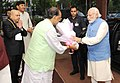 Narendra Modi being welcomed by the Union Minister for Agriculture and Farmers Welfare, Shri Radha Mohan Singh on his arrival, at the launching ceremony of the National Agriculture Market, in New Delhi.jpg