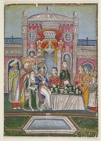Nasir-ud-Din Haidar Shah - Nasir al-Din Haidar Shah is seen seated at a table with a British officer on his left and an English lady on his right