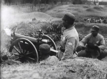NRA troops firing artillery at Communist forces National Revolutionary Army artillery.png