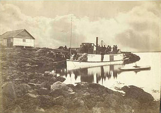 St. Michael, Alaska - The steamer New Racket hired by Al and Ed Schieffelin at the wharf of St. Michael, Alaska, in 1888 before its departure for the Yukon River.