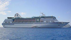 MS Empress of the Seas - MS Nordic Empress, featuring her original Royal Caribbean livery, anchored off the Cayman Islands in late March 2004