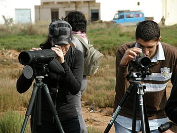 English: Students watching birds at Nador Lago...