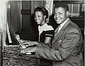 Oscar Peterson with his sister, Daisy, at the piano - 1944.jpg