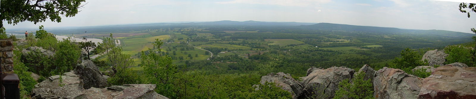 Panoramic view from Petit Jean Mountain overlook. Petit Jean's grave is just below, out of sight of the photo. The Arkansas River can be seen on the left. Petit jean panorama.JPG