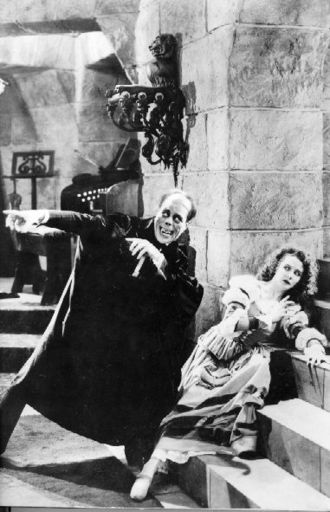 Christine Daaé - Christine Daaé (Mary Philbin) in the 1925 film The Phantom of the Opera, alongside Erik, The Phantom of the Opera (Lon Chaney).