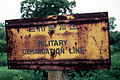 Photo of the Military Demarcation Line (MDL) sign (1993).JPEG