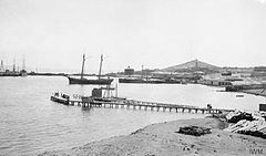 Photograph showing the location of the Russian wireless station at Baku with the Naval jetty extending to the immediate left of the picture.jpg