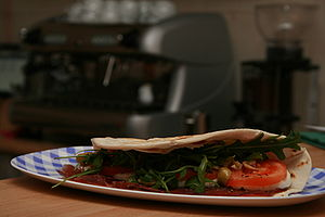 Sammarinese cuisine - A piada or a piadina with bresaola. Piadinas are not only Sammarinese dishes but are also common in the surrounding region, Emilia Romagna.