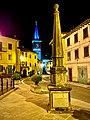 Piazza di Pievepelago con il campanile della Plebana di Santa Maria Assunta sullo sfondo.jpg