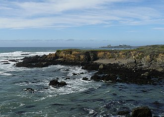 Piedras Blancas State Marine Reserve and Marine Conservation Area - Coastline of the Piedras Blancas SMCA. Piedras Blancas Light Station is in the background.