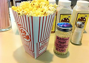 Popcorn seasoning - Plaza Theatre in Atlanta offers vegan visitors nutritional yeast for popcorn seasoning.